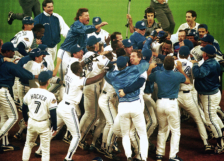 Toronto Blue Jays members mob teammate Joe Carter after his game winning home run in bottom of 9th in Game 6 of World Series, October 23, 1993.