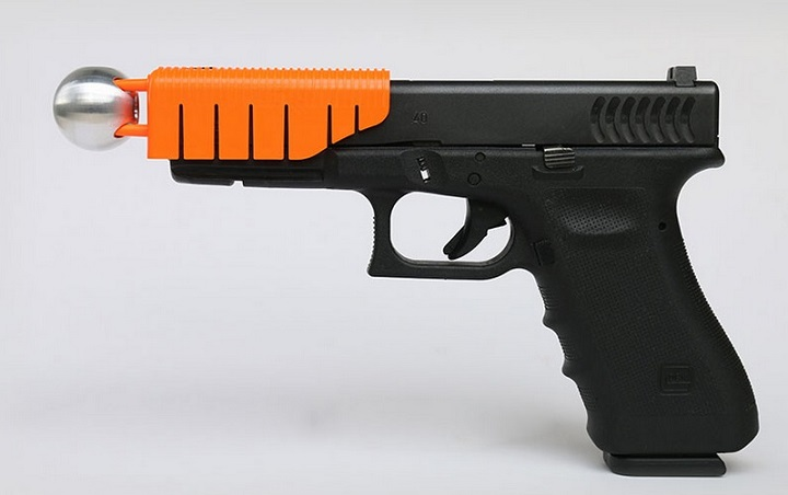 """The so-called """"clown gun"""" places a bullet-catching device in front of the muzzle to slow the first shot and reduce lethal force."""