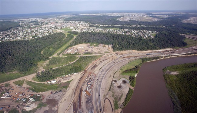 The Athabasca river, highway construction and suburbs seen from a helicopter in Fort McMurray, Alta., on July 10, 2012.
