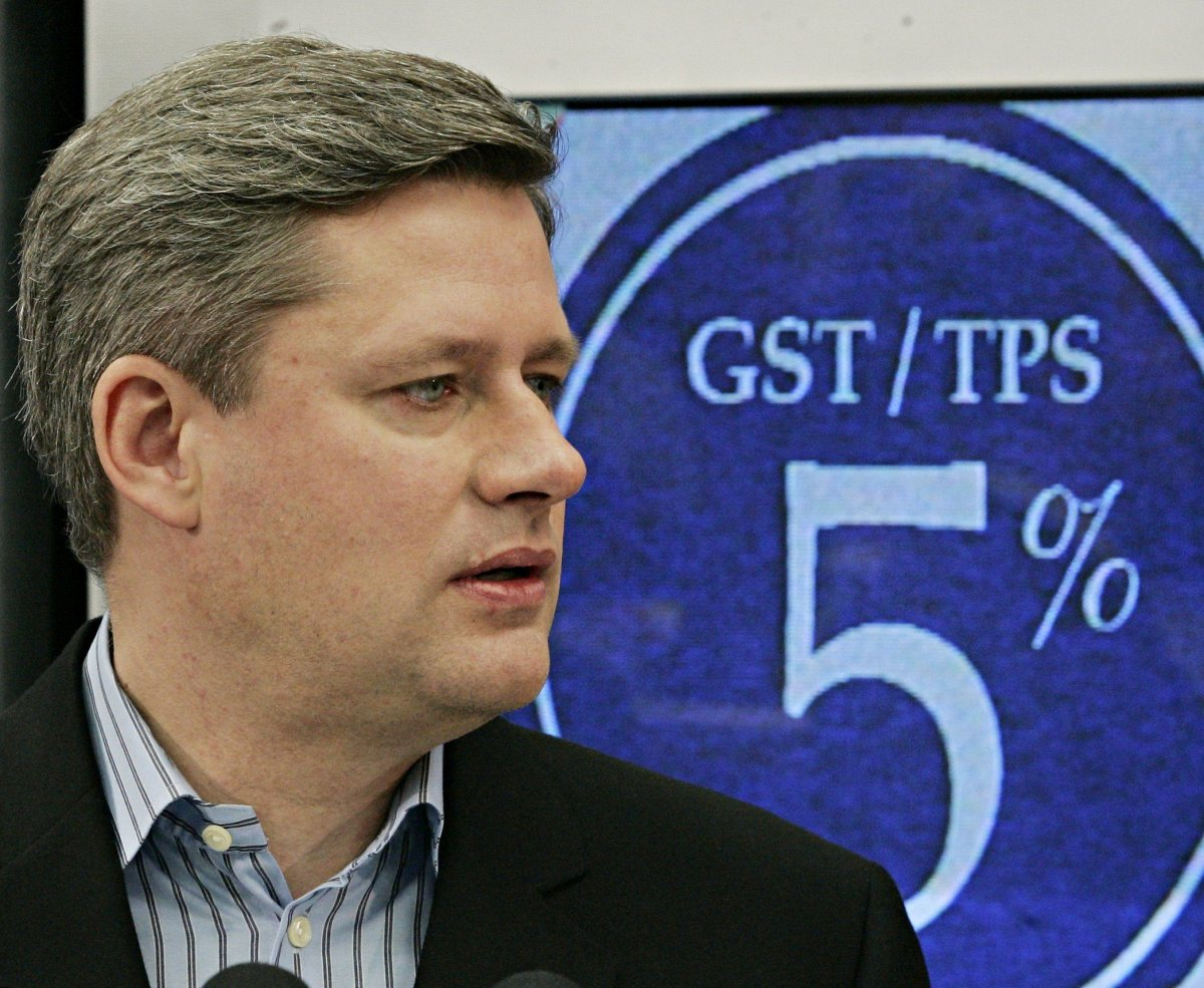 FILE-- Stephen Harper stands in front of a television displaying a 5% GST at an electronics store in Mississauga, Ont., in this December 1, 2005 file photo.