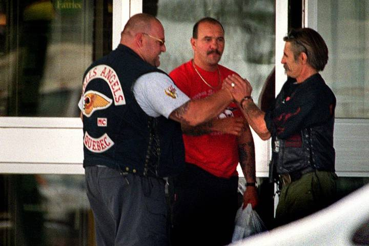 member of the Hells Angels motorcycle gang Quebec chapter (left) is greeted outside a hotel by a member of the Los Bravos in Winnipeg Friday July 21, 2000. CP PHOTO/The Winnipeg Free Press-Phil Hossack.