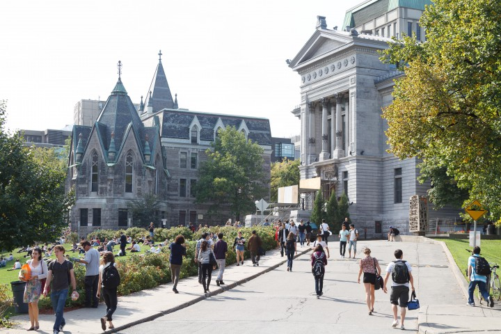 McGill entrance gate with students, Wednesday, August 19, 2015.