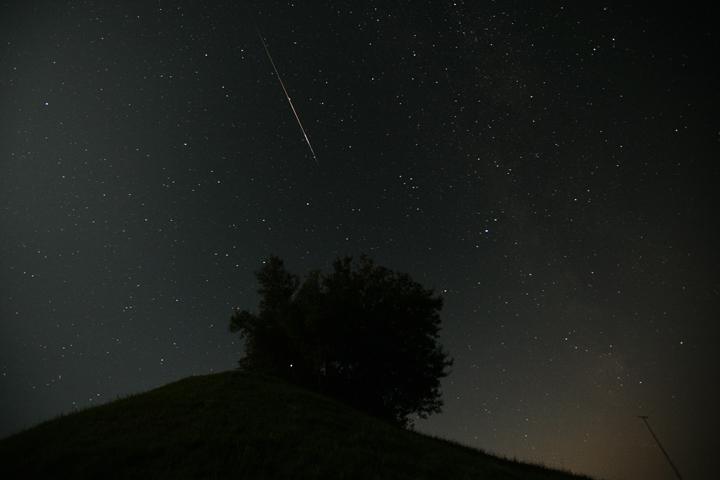 A meteor streaks across the sky in a file photo.