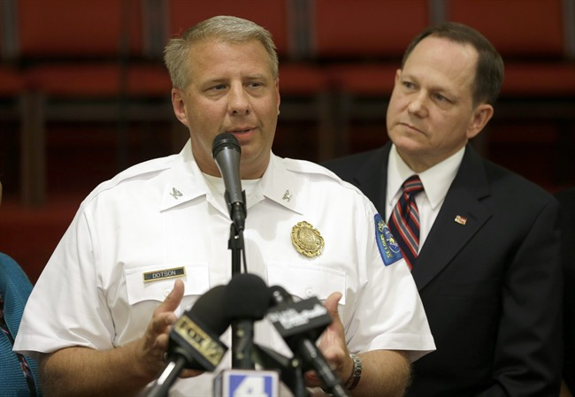 St. Louis police chief Sam Dotson, left, appeals for calm alongside mayor Francis Slay, Thursday, Aug. 20, 2015, West Side Missionary Baptist Church in St. Louis.