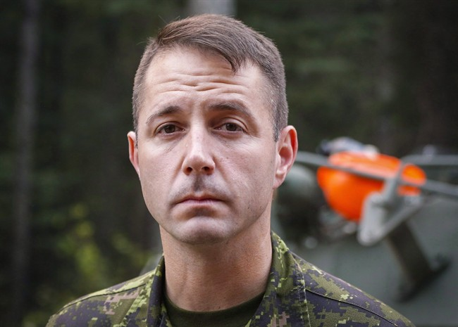 Lt.-Col. Mason Stalker is interviewed as Canadian troops fight fires in Montreal Lake, Sask., on July 9, 2015. A court appearance has been put over for a high-ranking military officer on sex charges. A lawyer appeared on behalf of Lt.-Col. Mason Stalker in Edmonton provincial court Thursday on 10 charges, including sexual assault.