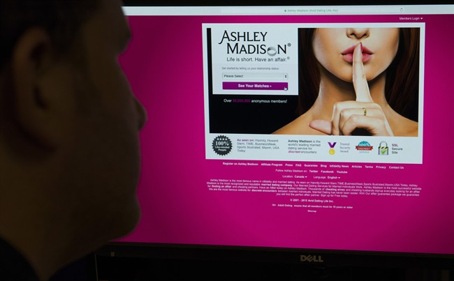 A man looks at the Ashley Madison website in this photo illustration in Toronto on Thursday, August 20, 2015.
