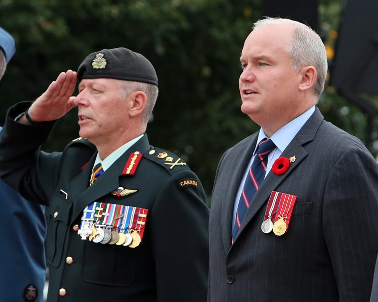 National Defence Chief Jonathan Vance, left, and Veterans Affairs Minister Erin O'Toole take part in a commemoration ceremony of the 70th anniversary of the end of the Second World War in the Far East, or V-J Day (Victory Over Japan) at the National War Memorial in Ottawa on Saturday, August 15, 2015.