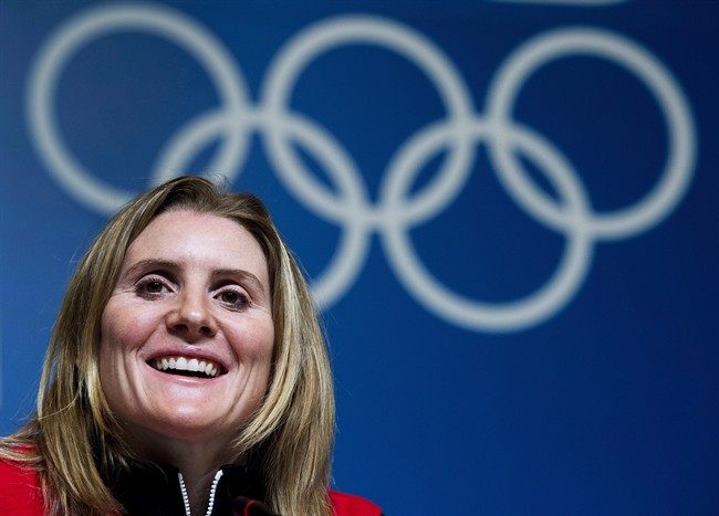 Hayley Wickenheiser smiles during a press conference before the 2014 Sochi Winter Olympics in Sochi, Russia on Wednesday, February 5, 2014.