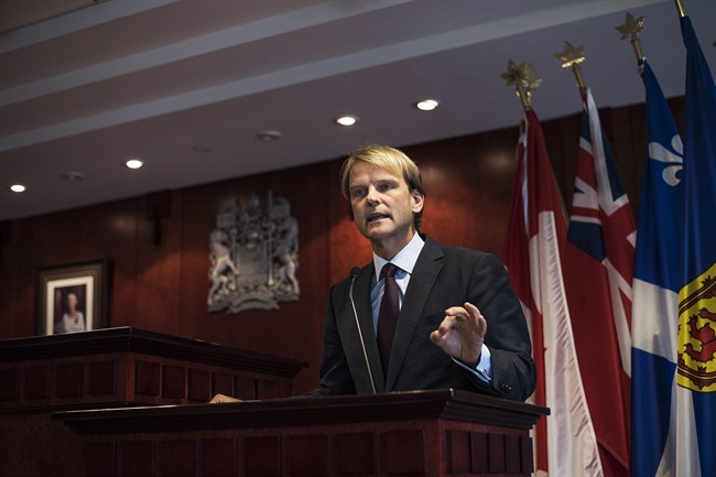 Minister of Citizenship and Immigration Chris Alexander speaks to the media about Canada's plan to provide faster help for Syrian and Iraqi Refugees wishing to come to Canada during a press conference in Toronto on Saturday, September 19, 2015.