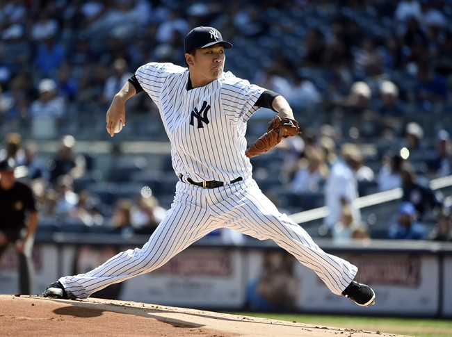 New York Yankees starter Masahiro Tanaka pitches in the first inning of a baseball game against the Toronto Blue Jays at Yankee Stadium, Sunday, Sept. 13, 2015, in New York.