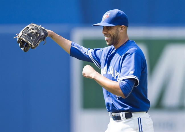 Toronto Blue Jays' starting pitcher David Price laughs after catching a line drive off the bat of Baltimore Orioles' Manny Machado during sixth inning MLB baseball action in Toronto on Saturday, September 5, 2015.