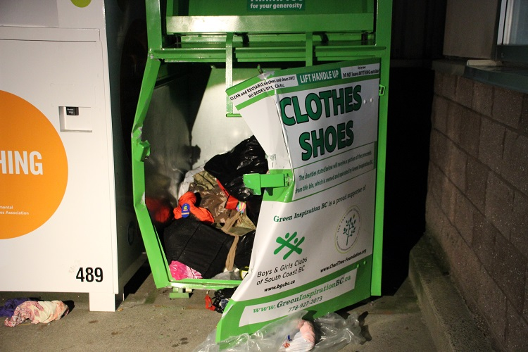 A 45-year-old homeless woman has died after being pulled from a clothing donation bin at a mall in Pitt Meadows.