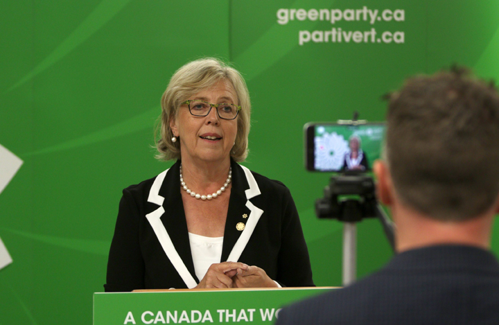 Twitter Canada, Steve Ladurantaye, records Green Party leader Elizabeth May, on his smart phone, to be uploaded to Twitter as she live-tweets to leaders during the Globe and Mail leaders' debate, in Victoria, B.C., on Thursday, September 17, 2015. Providing a real-time 30-second or less Tweet during the debate. THE CANADIAN PRESS/Chad Hipolito.
