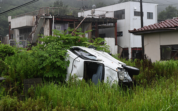 This photo taken on July 16, 2015 shows a vehicle and houses damaged by the March 11, 2011 tsunami still untouched after four years, in the village of Tomioka north of Naraha in Fukushima prefecture.