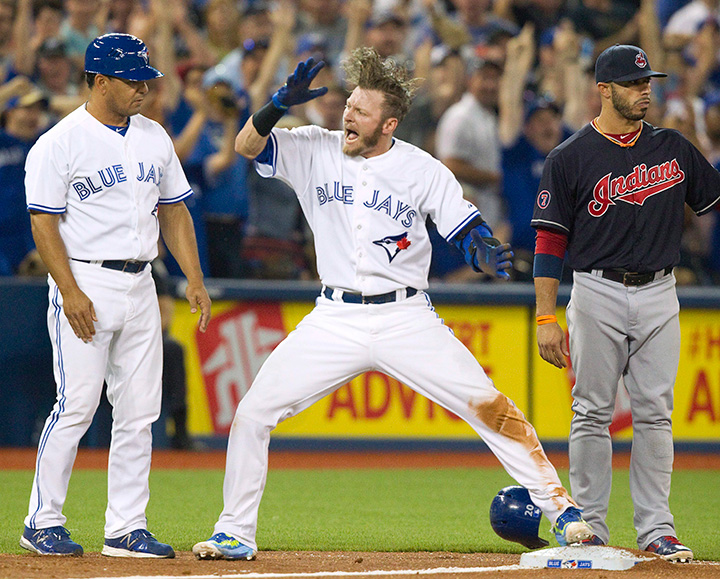 Toronto Blue Jays' Josh Donaldson celebrates after sliding safely into third base with a triple against the Cleveland Indians during fifth inning AL baseball action in Toronto on Monday, August 31, 2015.