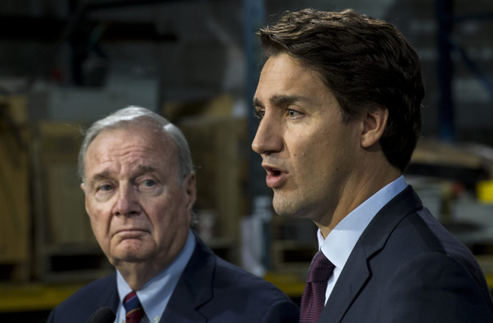 Liberal leader Justin Trudeau addresses supporters next to former prime minister Paul Martin Friday, August 28, 2015 in Montreal. THE CANADIAN PRESS/Paul Chiasson.