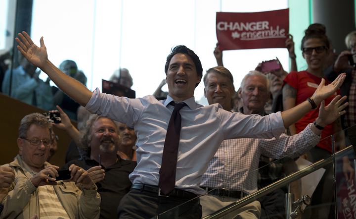 Liberal Leader Justin Trudeau reacts to the crowd as he arrives at a campaign stop in Orleans, Ont., on Sept. 21, 2015.