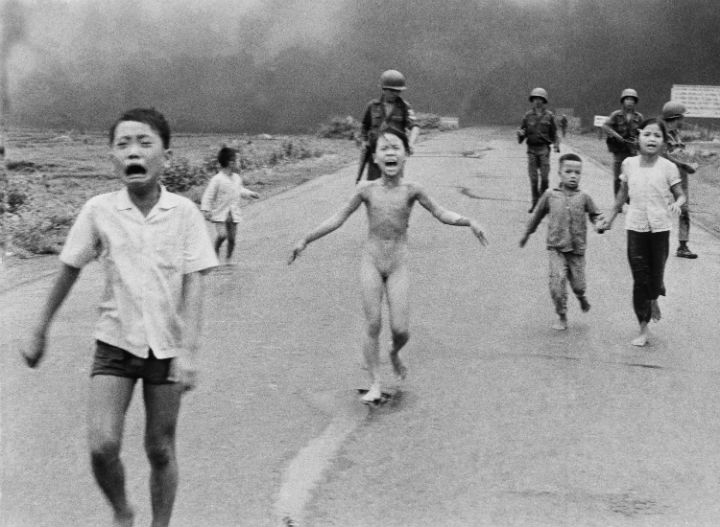 In this June 8, 1972 file photo, South Vietnamese forces follow after terrified children, including 9-year-old Kim Phuc, center, as they run down Route 1 near Trang Bang after an aerial napalm attack on suspected Viet Cong hiding places.