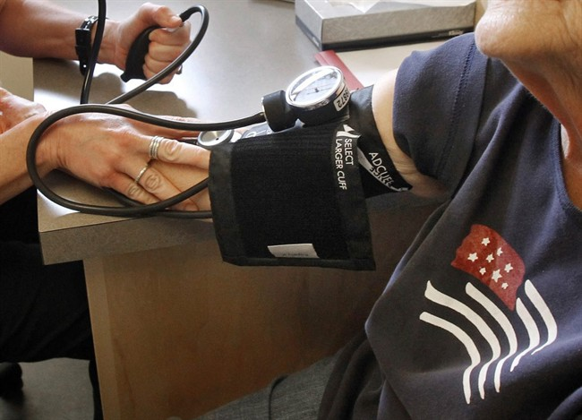 A patient has her blood pressure checked by registered nurse in Plainfield, Vt.