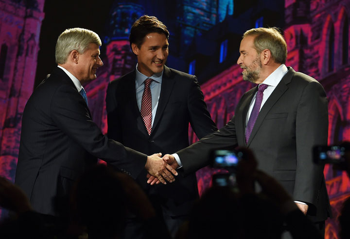 NDP leader Tom Mulcair shakes hands with Conservative leader Stephen Harper as Liberal leader Justin Trudeau looks on during their introduction prior to the Globe and Mail hosted leaders' debate in Calgary on Thursday, September 17, 2015.