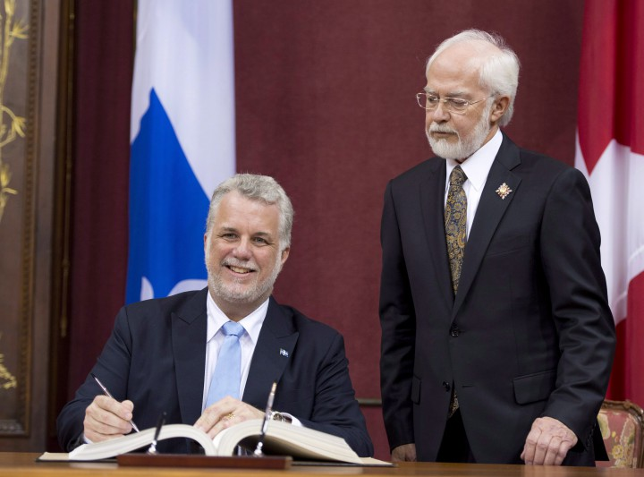 Quebec Premier Philippe Couillard is sworn in by then Lt. Governor Pierre Duchesne during a ceremony Wednesday, April 23, 2014 at the legislature in Quebec City.