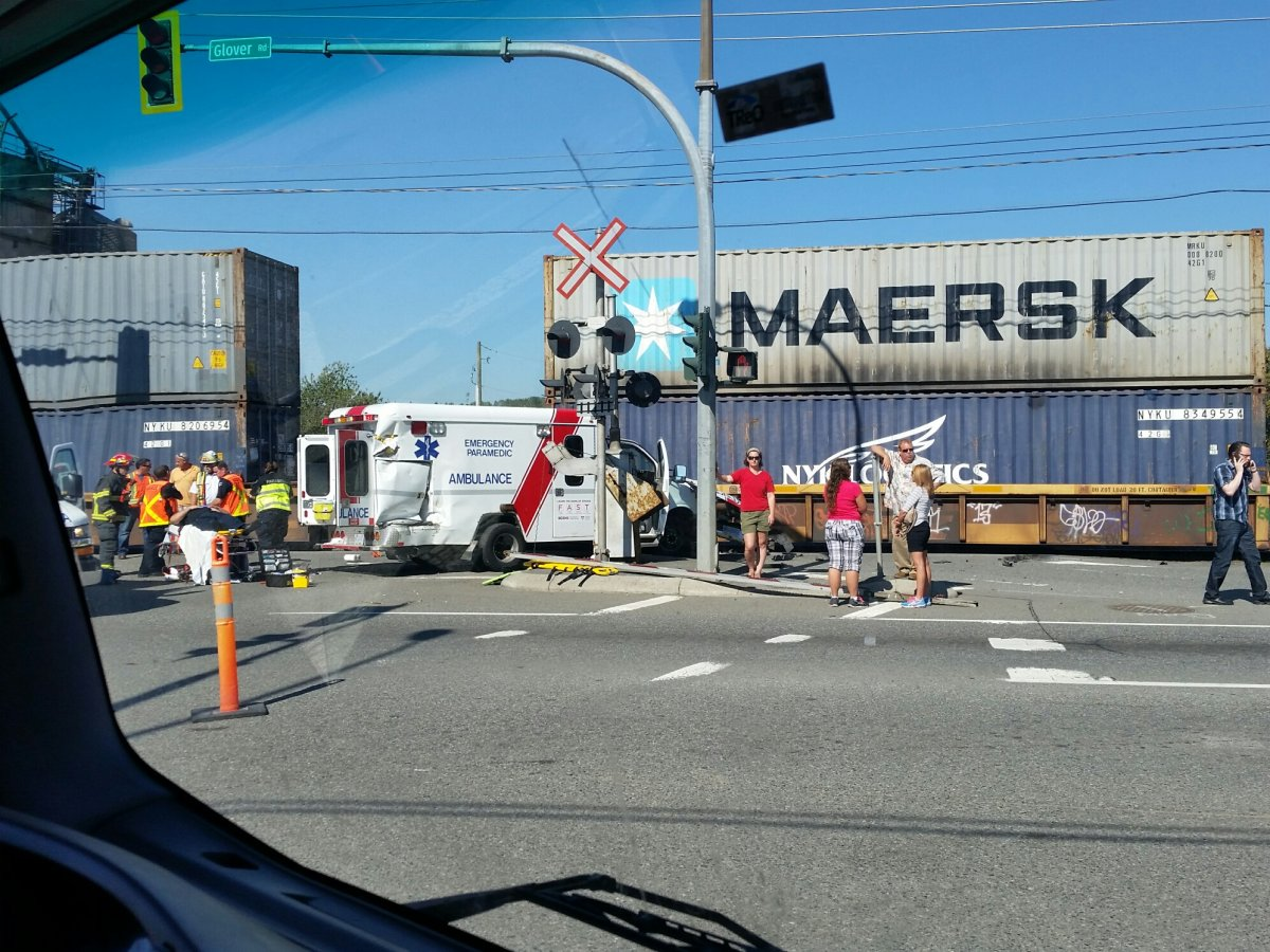Emergency crews on scene of a collision between a train and an ambulance in Langley.
