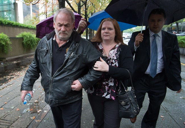 Ivan Henry, left, who was wrongfully convicted of sexual assault in 1983, and his daughter Tanya Olivares, centre, leave B.C. Supreme Court during a lunch break in Vancouver, B.C., on Monday August 31, 2015. Henry is suing prosecutors for allegedly breaching his charter rights after he was acquitted in 2010 of 10 sexual-assault convictions.