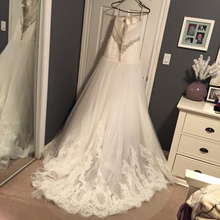 A bride-to-be is selling her wedding dress and her ad explains why.