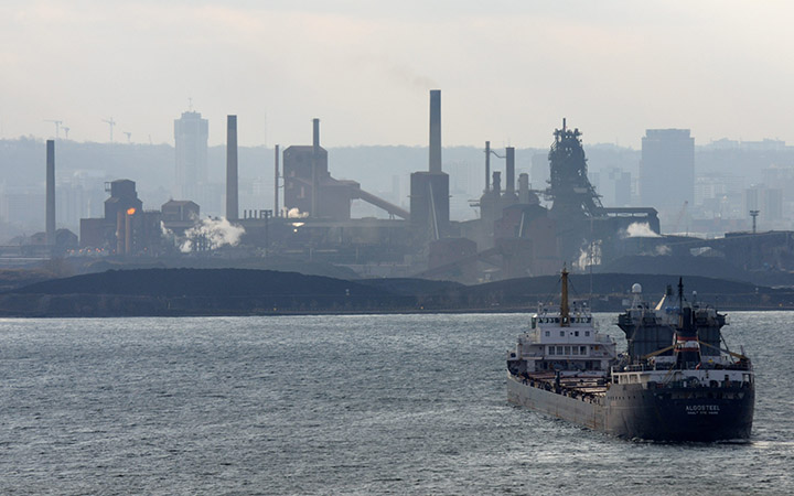 Ship AlgoSteel about to dock in Hamilton with a load of iron ore.