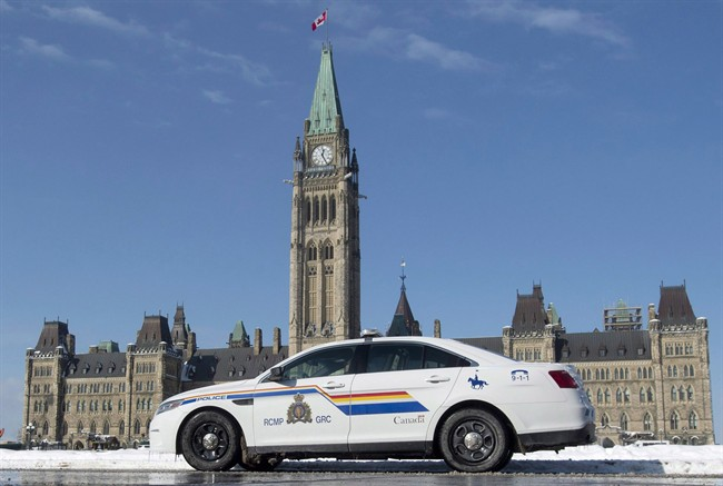 An RCMP police car sits outside the Parliament buildings on Parliament Hill in Ottawa, Friday, February 6, 2015.