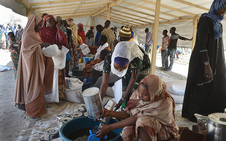 Refugees wait for food at the UNHCR Refugee Camp at Dar es Salaam near Baga Sola, Chad Refugees escape from Boko Haram in Nigeria to Chad, Africa - Feb 2015.
