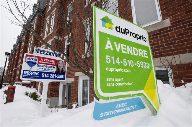 For sale signs are seen in front of a Montreal condominium.