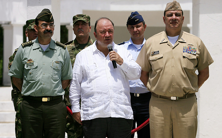 Colombian Defense Minister Luis Carlos Villegas speaks to the press flanked by top Colombian Armed Forces Commanders, to announce the killing of drugs lord and guerrillas leader Victor Ramon Navarro aka Megateo by Colombian authorities, during a military operation at Cataumbo region bordering Venezuela, in Santa Marta on October 2, 2015.
