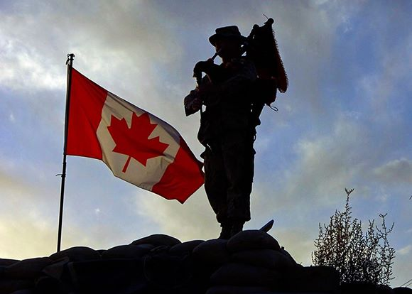 A photo from the Veterans Voices of Canada flag raising from 2014.