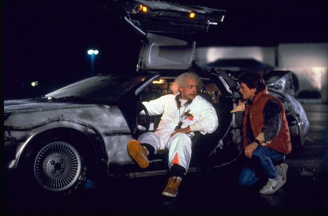 "This photo provided by Universal Pictures Home Entertainment shows Christopher Lloyd, left, as Dr. Emmett Brown, and Michael J. Fox as Marty McFly in the 1985 film, ""Back to the Future."" ."