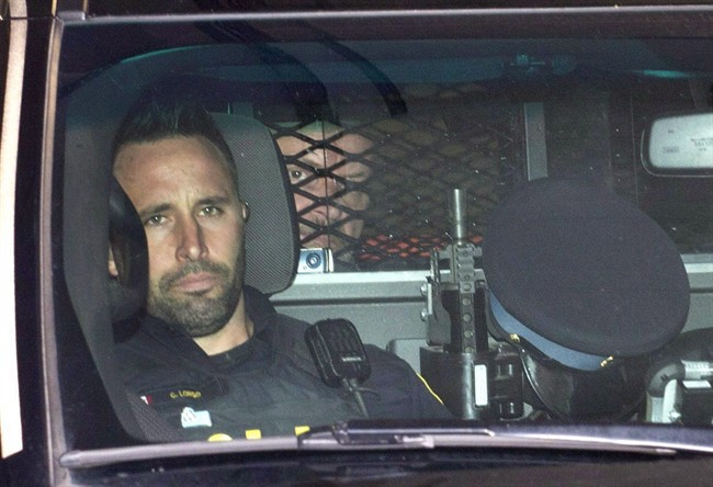 Basil Borutski leaves in a police vehicle after appearing at the courthouse in Pembroke, Ont. on Sept. 23, 2015.