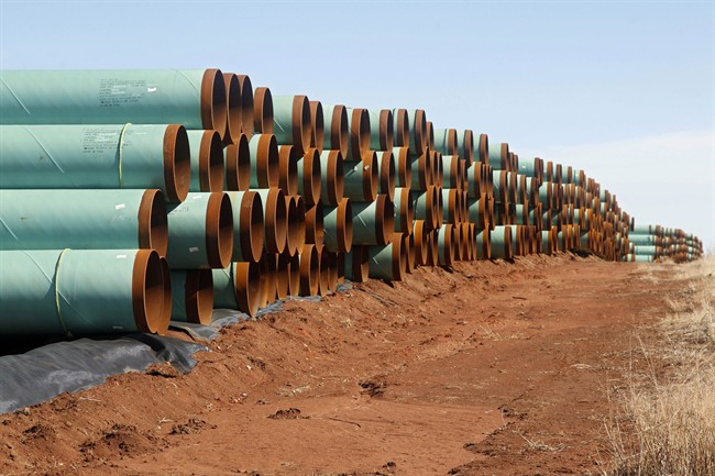 Miles of pipe for the stalled Canada-to-Texas Keystone XL pipeline are stacked in a field near Ripley, Okla.,.