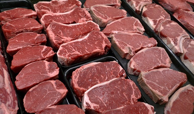 File photo of steaks and other beef products displayed for sale at a grocery store in McLean, Va., on Jan. 18, 2010.