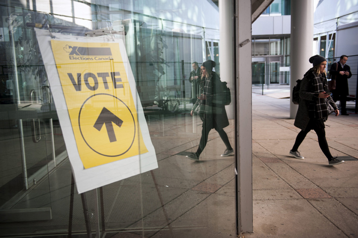 An Elections Canada sign points voters towards the polls at Metro Hall in Toronto on Monday, Oct. 19, 2015. THE CANADIAN PRESS/Marta Iwanek.