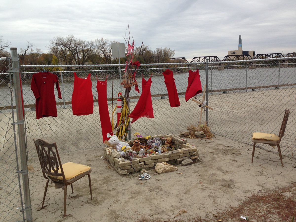 Dresses overlook the makeshift memorial for slain teen Tina Fontaine.