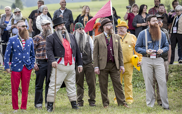 Contestants of the World Beard And Mustache Championships pose for a picture during the opening ceremony of the Championships 2015 on October 3, 2015 in Leogang, Austria.