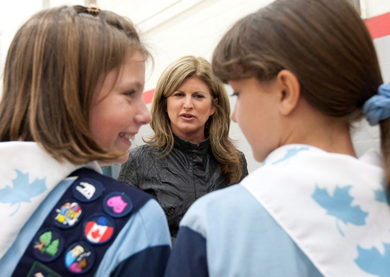 Rona Ambrose speaks with two Girl Guides before launching a call for proposals for Women's History month at an event in Ottawa, Tuesday June 5, 2012. Ambrose is now effectively in charge of one of the toughest files in government, the F-35 fighter jet purchase.