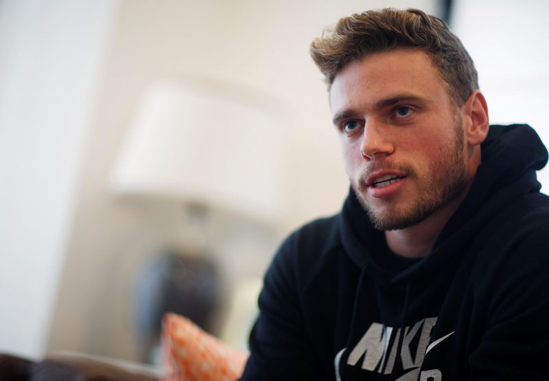 In this Wednesday, Oct. 21, 2015, photo, Gus Kenworthy, a freestyle skier who won a silver medal in Sochi, poses in his home in Denver.