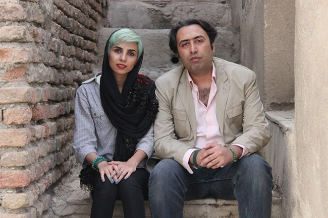 In this undated photo made available by International Campaign for Human Rights in Iran, Iranian poets Fatemeh Ekhtesari , left, and Mehdi Mousavi pose in unknown place in Iran. Two Iranian poets known for prose probing modern life face years in prison for their work and 99 lashes apiece for shaking hands with members of the opposite sex, the latest targets of a crackdown on expression in the Islamic Republic. (International Campaign for Human Rights in Iran via AP).