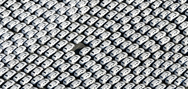 In this Sept. 30, 2015 file photo new cars of Volkswagen AG stand at the car terminal in Emden, Germany.