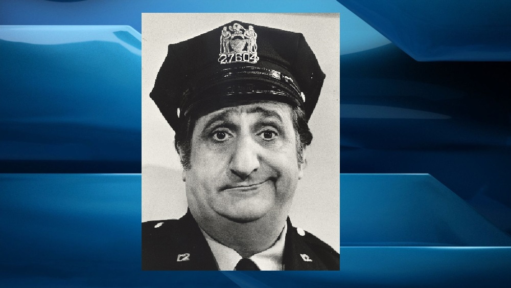 """In a photo, provided in 1974 by ABC, actor Al Molinaro poses dressed as Murray the cop. Molinaro, the loveable character actor with the hangdog face who was known to millions of TV viewers for playing Murray on """"The Odd Couple"""" and malt shop owner Al Delvecchio on """"Happy Days,"""" died Friday, Oct. 30, 2015, at Verdugo Hills Hospital in Glendale, Calif., his son Michael Molinaro said. He died of complications of gallstone problems, his son said. He was 96."""