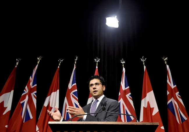 Yasir Naqvi, Ontario Minister of Community Safety and Correctional Services, explains a draft regulation for public input that would prohibit the random and arbitrary collection of identifying information by police, referred to as carding or street checks at Queen's Park in Toronto on Wednesday, October 28, 2015.