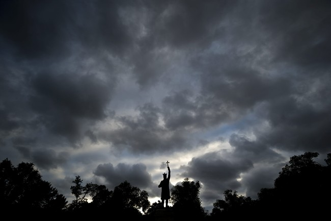 This Thursday, May 28, 2015 photo shows a statue of Stephen the Great (Stefan cel Mare in Romanian) silhouetted against a cloudy sky in Chisinau, the capital of Moldova.