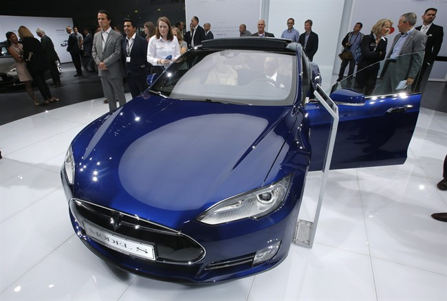 FILE - In this Sept. 15, 2015 file photo, a Tesla Model S is on display on the first press day of the Frankfurt Auto Show IAA in Frankfurt, Germany.