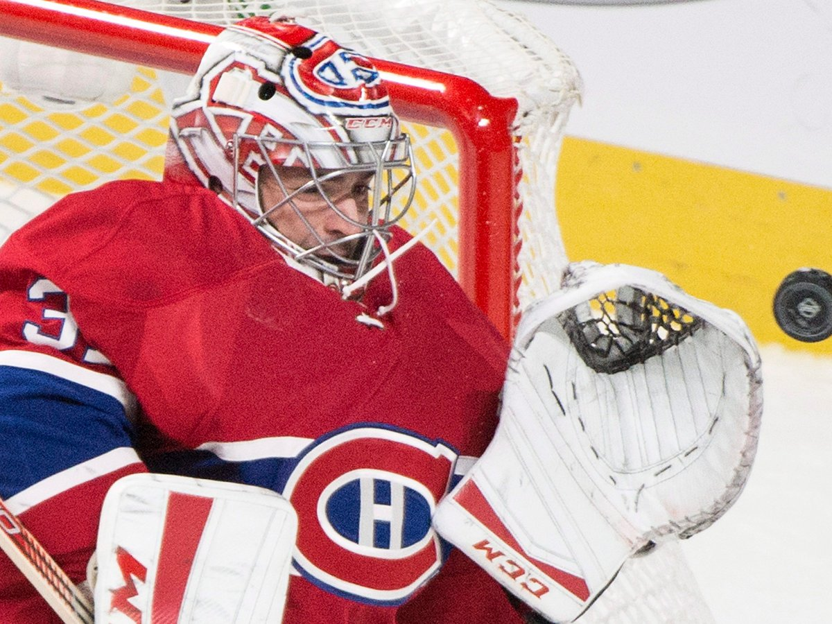 Montreal Canadiens goaltender Carey Price makes a save against the Saint Louis Blues during third period NHL hockey action in Montreal, Tuesday, October 20, 2015.